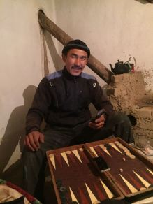 My host, on the border, trying to teach me Backgammon... in Russian