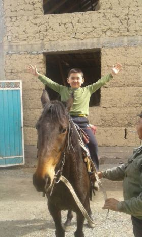 MIsha's son on a horse